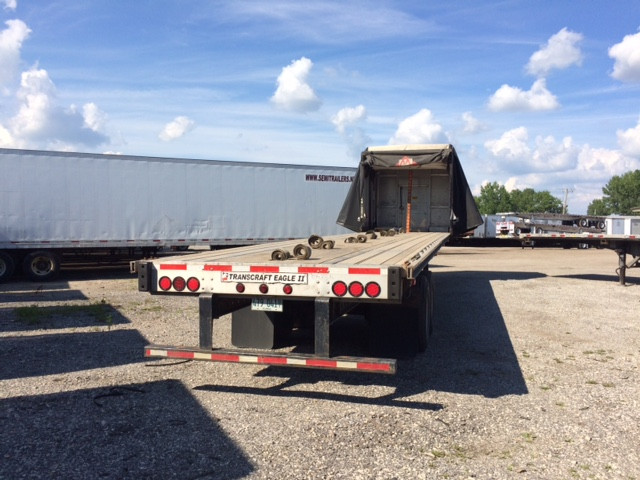 2007 Transcraft Flatbeds with Rolling Tarp Systems. Picture representative of fleet.
