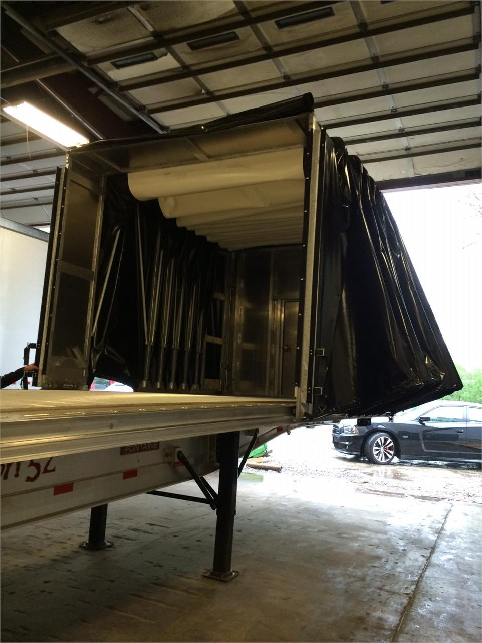 Tarping system by Load Covering Solutions. ILoca Services will sell and install this and other semi-trailer aluminum products. This model and brand is currently in stock .